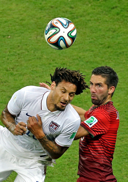 . United States\' Jermaine Jones, left, and Portugal\'s Joao Moutinho challenge for the ball during the group G World Cup soccer match between the USA and Portugal at the Arena da Amazonia in Manaus, Brazil, Sunday, June 22, 2014. (AP Photo/Themba Hadebe)