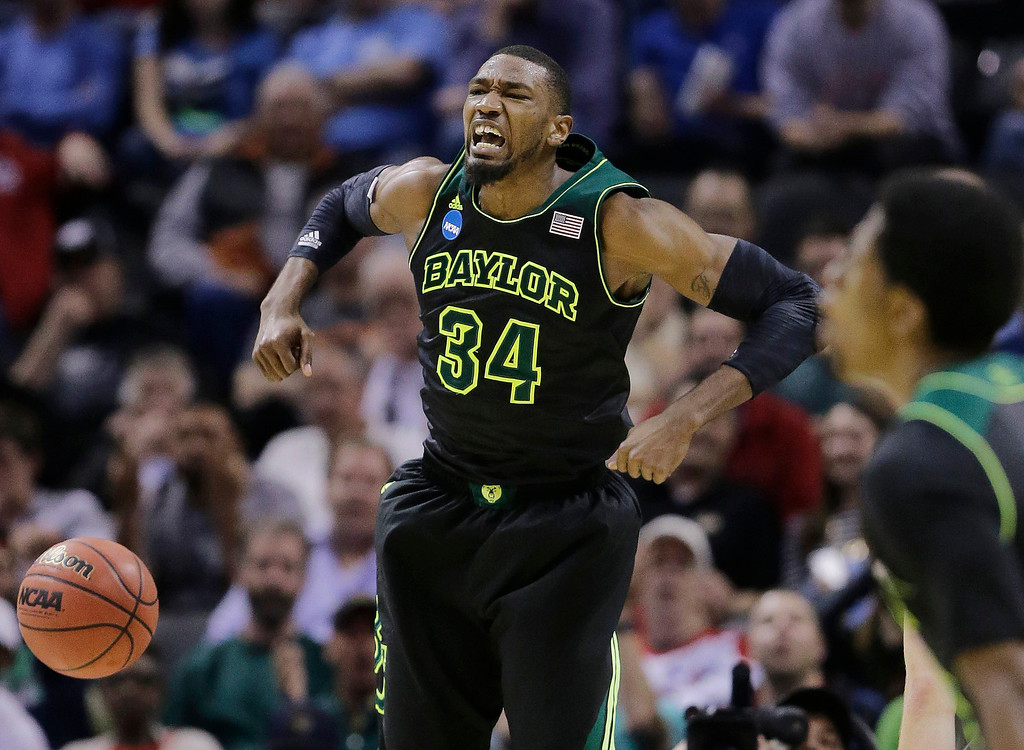 . Baylor\'s Cory Jefferson (34) yells as he scores against Creighton during the second half of a third-round game in the NCAA college basketball tournament Sunday, March 23, 2014, in San Antonio. (AP Photo/Eric Gay)