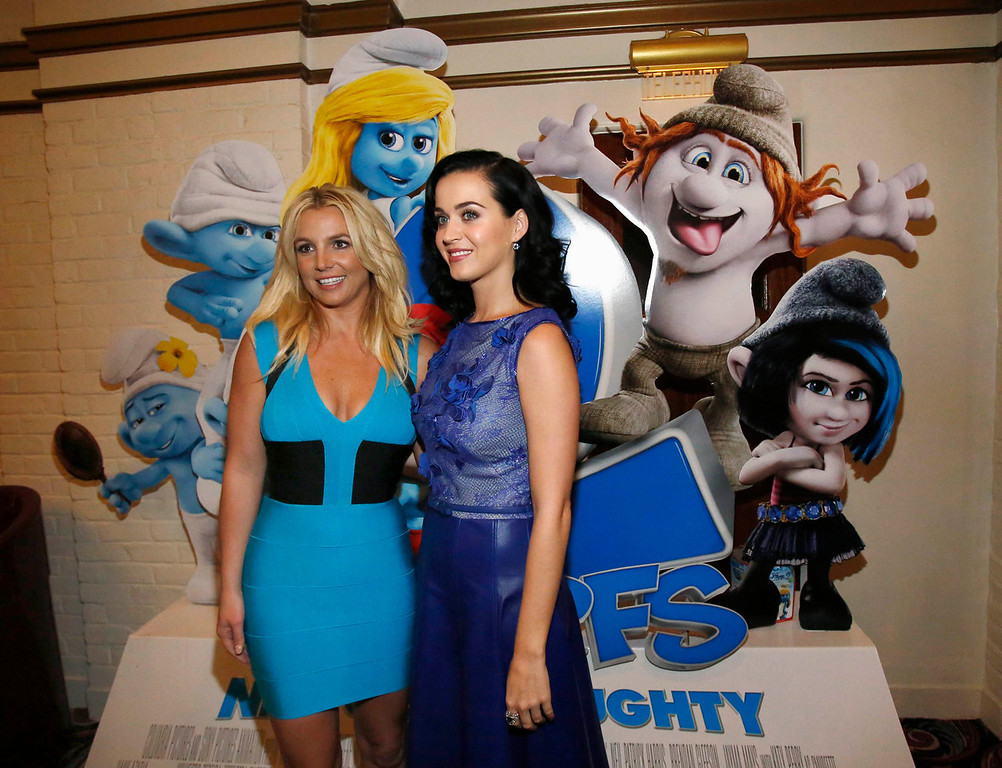""". Singers Britney Spears (L) and Katy Perry pose at the premiere of \""""The Smurfs 2\"""" at the Regency Village theatre in Los Angeles, California July 28, 2013. Spears performed the song \""""Ooh La La\"""" from the movie, and Perry voiced the character \""""Smurfette\"""". The movie opens in the U.S. on July 31.  REUTERS/Mario Anzuoni"""