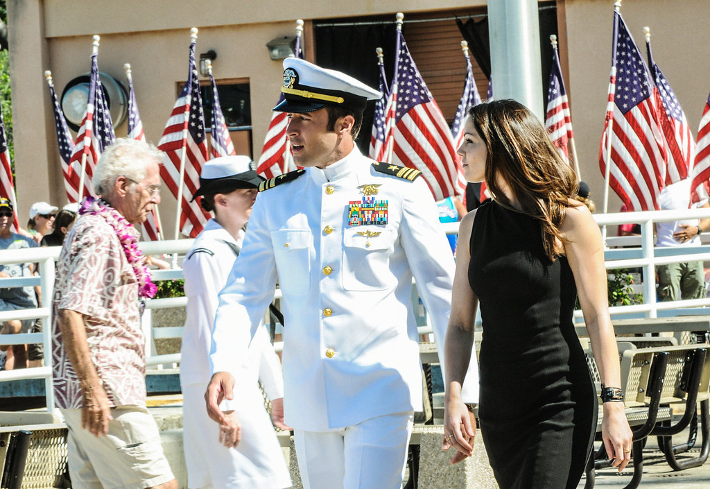 . When McGarrett (Alex O\'Loughlin, left, with Michelle Borth, right) prevents the murder of a Pearl Harbor veteran at a remembrance ceremony, Five-0 must use decades old evidence to investigate a heinous crime committed within the internment camps on Oahu during World War II, on HAWAII FIVE-0, Friday, Dec 13  (9:00-10:00 PM, ET/PT) on the CBS Television Network.  (Photo by Norman Shapiro/CBS Broadcasting)