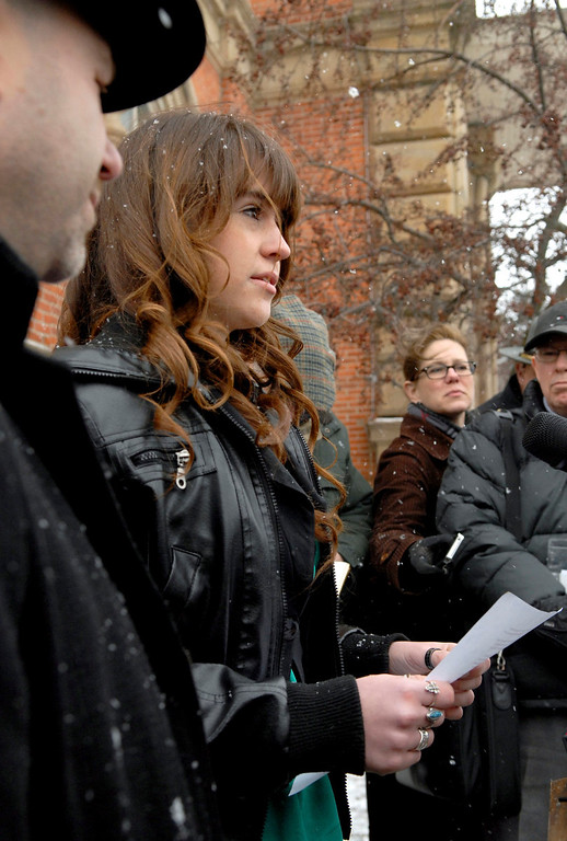 . Sadie Lane, sister of T.J. Lane, reads a statement to the media after the sentencing of T.J. Lane on Tuesday, March 19, 2013 in Chardon, Ohio. Lane, was given three lifetime prison sentences without the possibility of parole Tuesday for opening fire last year in a high school cafeteria in a rampage that left three students dead and three others wounded. Lane, 18, had pleaded guilty last month to shooting at students in February 2012 at Chardon High School, east of Cleveland.  (AP Photo/The News-Herald, Jeff Forman)