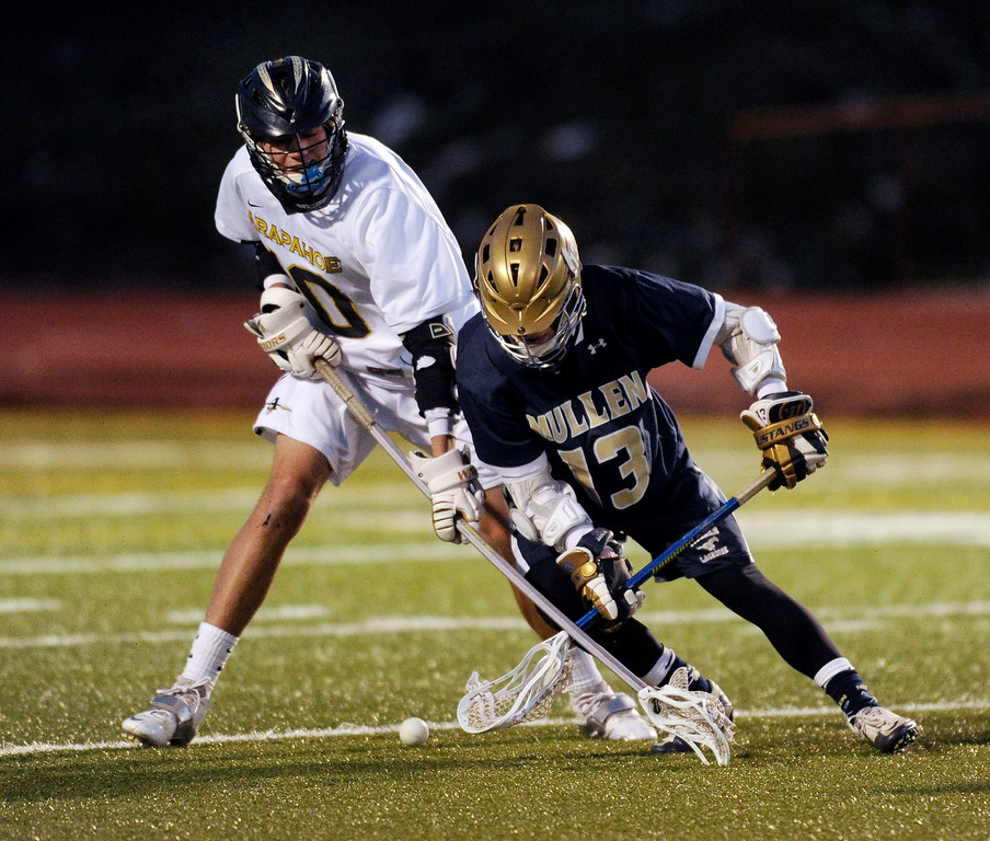 . LITTLETON, CO. - APRIL 10: Arapahoe defenseman Drew Danuser (10) crossed sticks with Mullen attack Grant Alfred as they went for a loose ball in the third quarter. The Mullen High School boy\'s lacrosse team defeated Arapahoe 8-7 Wednesday night, April 10, 2013. Photo By Karl Gehring/The Denver Post)