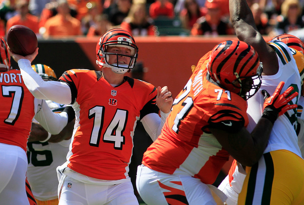 . Cincinnati Bengals quarterback Andy Dalton (14) passes against the Green Bay Packers in the first half of an NFL football game, Sunday, Sept. 22, 2013, in Cincinnati. (AP Photo/Tom Uhlman)