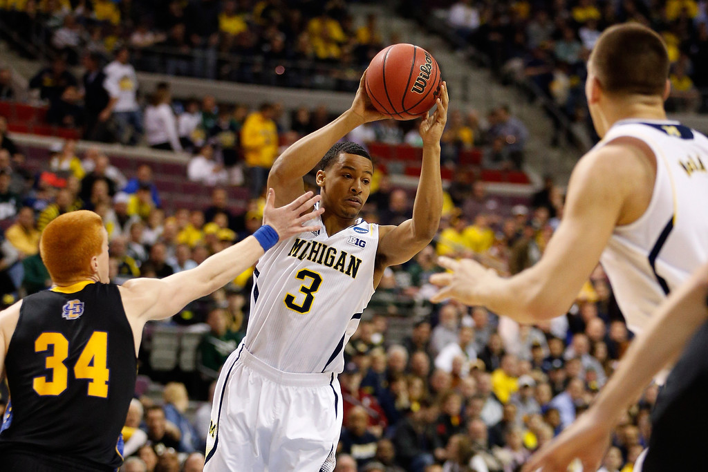 . Trey Burke #3 of the Michigan Wolverines looks to pass the ball in the first half against the South Dakota State Jackrabbits during the second round of the 2013 NCAA Men\'s Basketball Tournament at at The Palace of Auburn Hills on March 21, 2013 in Auburn Hills, Michigan.  (Photo by Gregory Shamus/Getty Images)