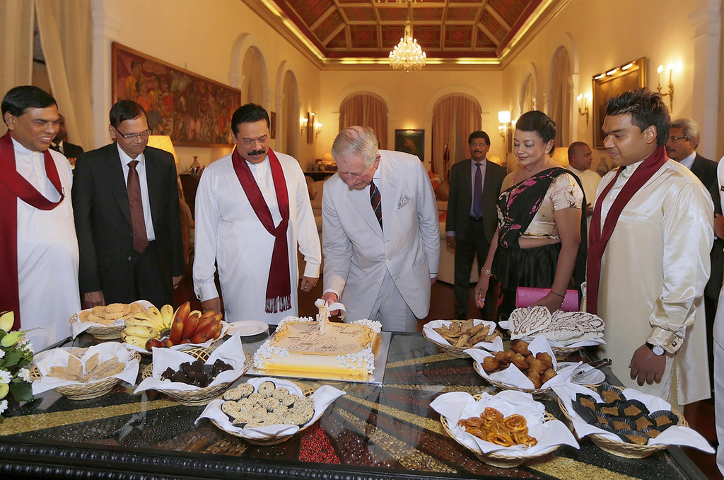 . In this handout photograph received from the President\'s Office on November 14, 2013 Britain\'s Prince Charles (C-R), accompanied by Sri Lankan President Mahinda Rajapaksa (C-L), cuts a birthday cake during a reception at the President\'s residence in Colombo on November 14, 2013.    AFP PHOTO / PRESIDENT\'S OFFICE-HO/AFP/Getty Images