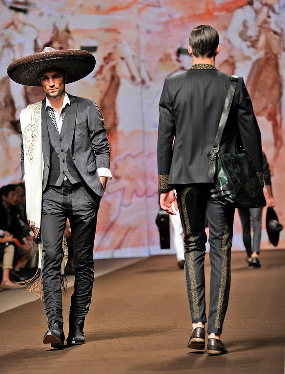 . Models wear creations for Etro men\'s Spring-Summer 2014 collection, part of the Milan Fashion Week, unveiled in Milan, Italy, Monday, June 24, 2013.  (AP Photo/Giuseppe Aresu)