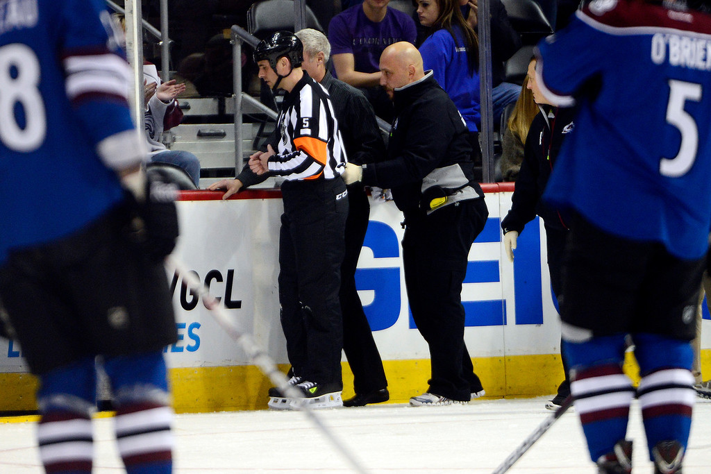 . DENVER, CO. - FEBRUARY 4: Referee Chris Rooney skates off the ice after being struck by a puck during the first period of action. Colorado Avalanche versus the Dallas Stars at the Pepsi Center on February 4, 2012. (Photo By AAron Ontiveroz/The Denver Post)