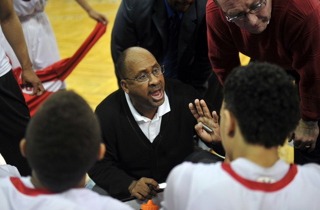 . DENVER, CO. - MARCH 08: Denver East High School boy\'s basketball team head coach Rudy Carey gives advices to the players at Denver Coliseum during 5A state quarter final game against Arapahoe High School. East won 60-55. March 8, 2013. Denver, Colorado. (Photo By Hyoung Chang/The Denver Post)