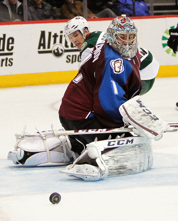 . Colorado Avalanche goalie Semyon Varlamov (1), of Russia, makes a save against the Minnesota Wild during the second period of an NHL hockey game Thursday, Jan. 30, 2014, in Denver. (AP Photo/Barry Gutierrez)