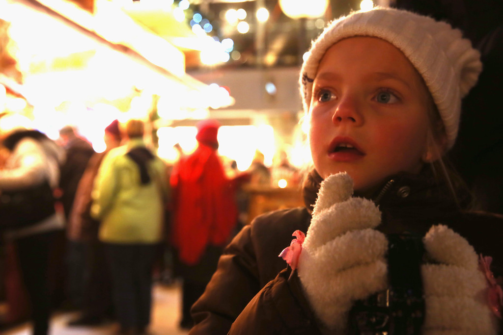 . child enjoying a warm traditional children\'s fruit punch at the annual Christmas market at Marienplatz and the Town Hall on its opening day on November 25, 0213 in Munich, Germany.  (Photo by Alexander Hassenstein/Getty Images)