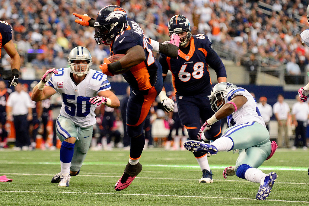 . ARLINGTON, TX - OCTOBER 6: Knowshon Moreno (27) of the Denver Broncos leaps over J.J. Wilcox (27) of the Dallas Cowboys during the first half of action at AT&T Stadium. The Denver Broncos visit the Dallas Cowboys. (Photo by AAron Ontiveroz/The Denver Post)
