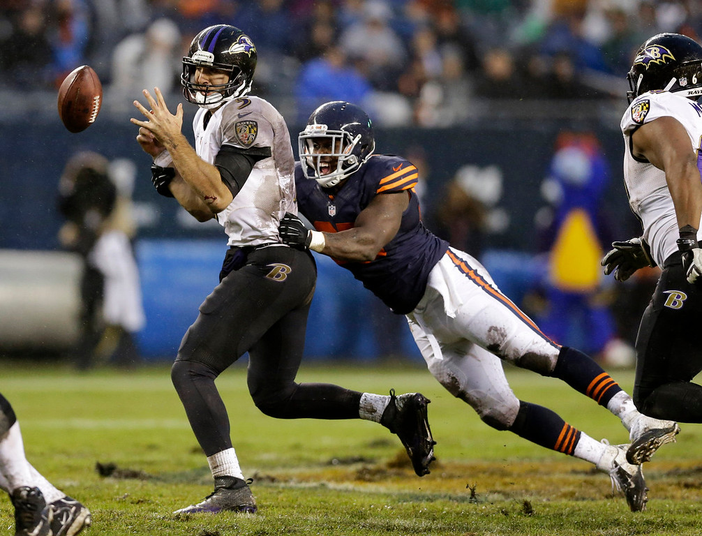 . Chicago Bears linebacker Larry Grant, right, sacks Baltimore Ravens quarterback Joe Flacco (5) during the second half of an NFL football game, Sunday, Nov. 17, 2013, in Chicago. (AP Photo/Nam Y. Huh)