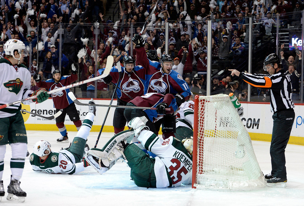 . Colorado Avalanche defenseman Nick Holden (2) and Colorado Avalanche left wing Jamie McGinn (11) celebrate Holden\'s first goal of the game during the first period.   (Photo by John Leyba/The Denver Post)