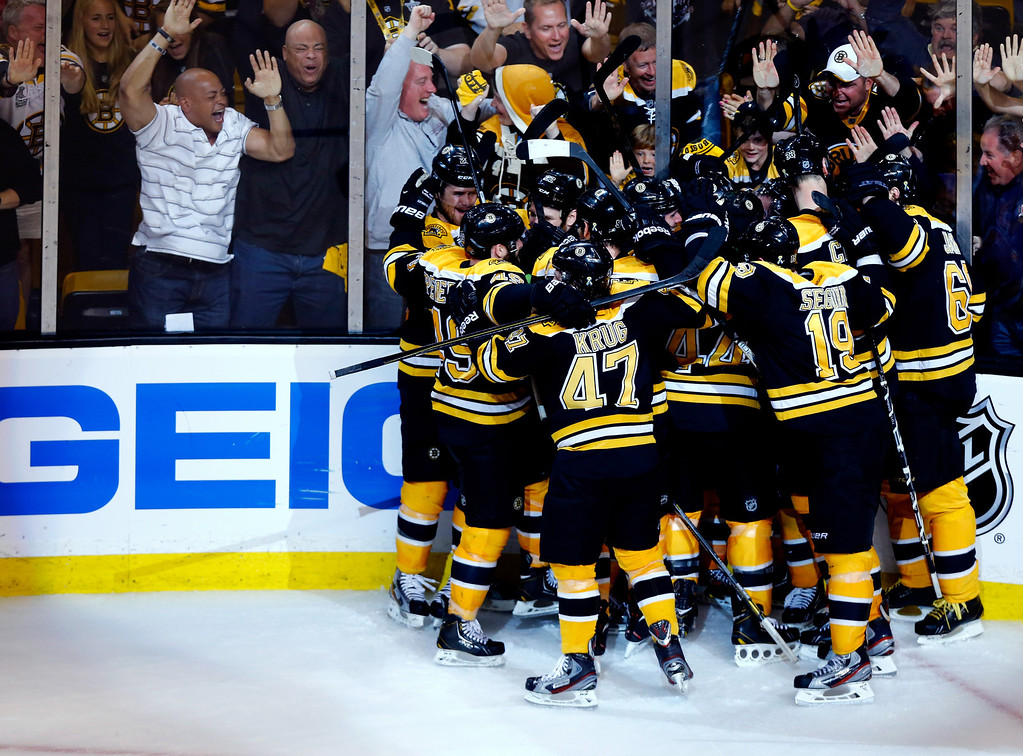 . The Boston Bruins celebrate a double overtime victory, 2-1, over the Pittsburgh Penguins on a goal scored by Patrice Bergeron in Game Three of the Eastern Conference Final of the 2013 NHL Stanley Cup Playoffs at the TD Garden on June 5, 2013 in Boston, Massachusetts.  (Photo by Jared Wickerham/Getty Images)