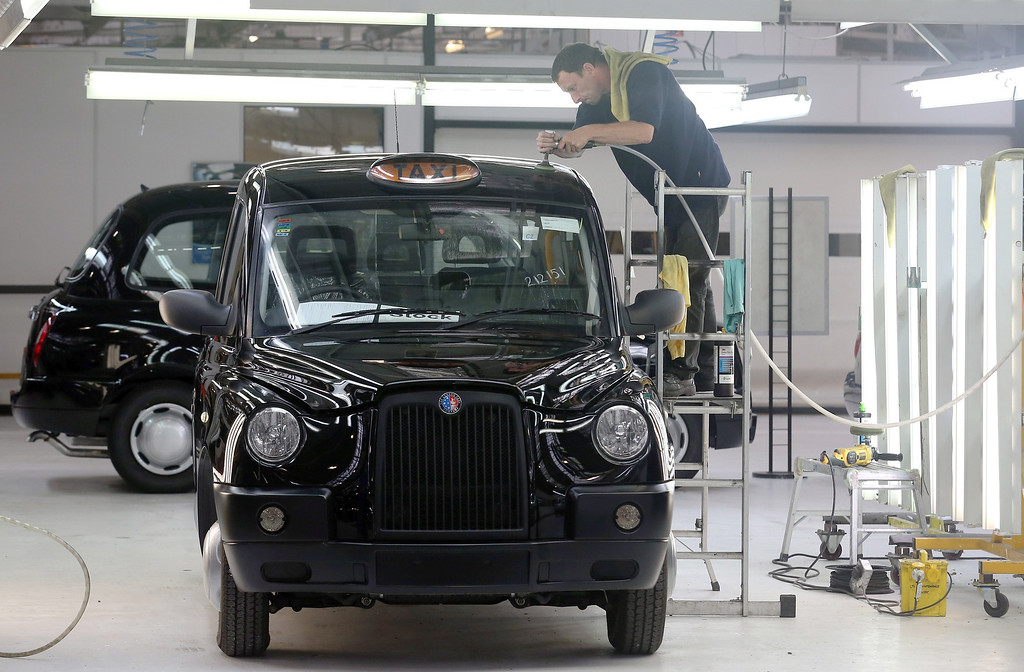 . A worker inside the factory of The London Taxi Company polishes a TX4 (Euro 5) London Taxi on September 11, 2013 in Coventry, England.   (Photo by Matt Cardy/Getty Images)