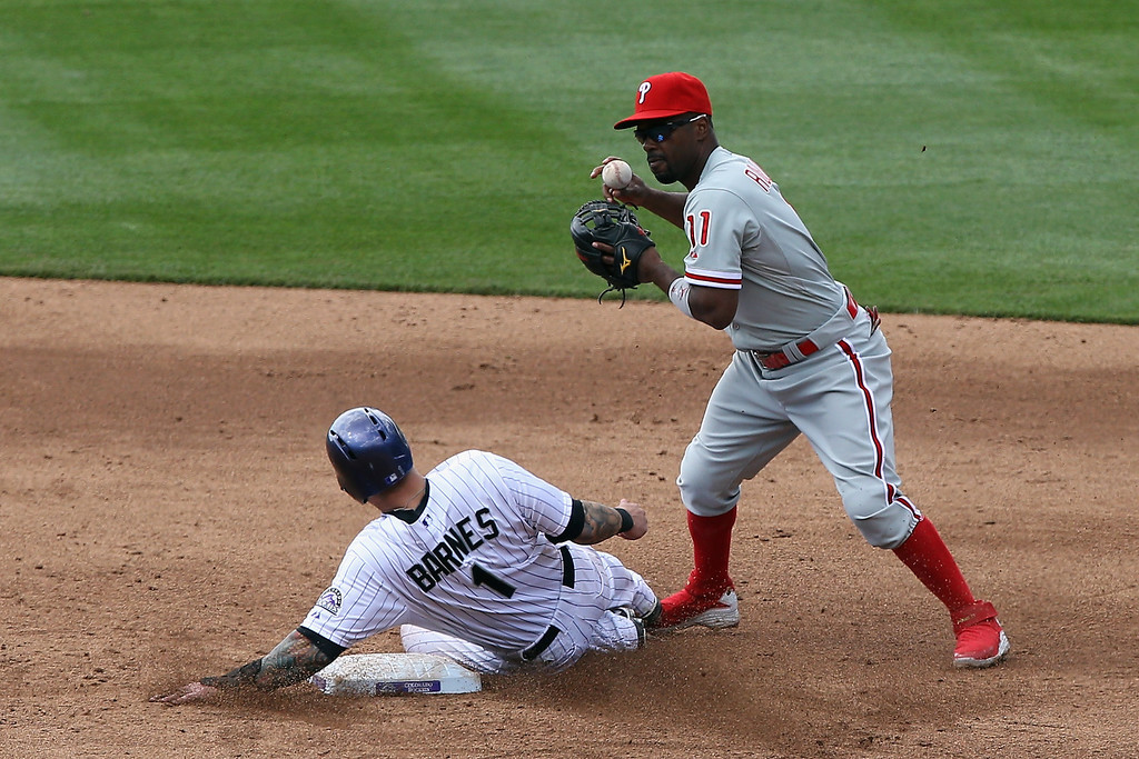 . Shortstop Jimmy Rollins #11 of the Philadelphia Phillies gets a force out on Brandon Barnes #1 of the Colorado Rockies at second base in the third inning at Coors Field on April 20, 2014 in Denver, Colorado.  (Photo by Doug Pensinger/Getty Images)