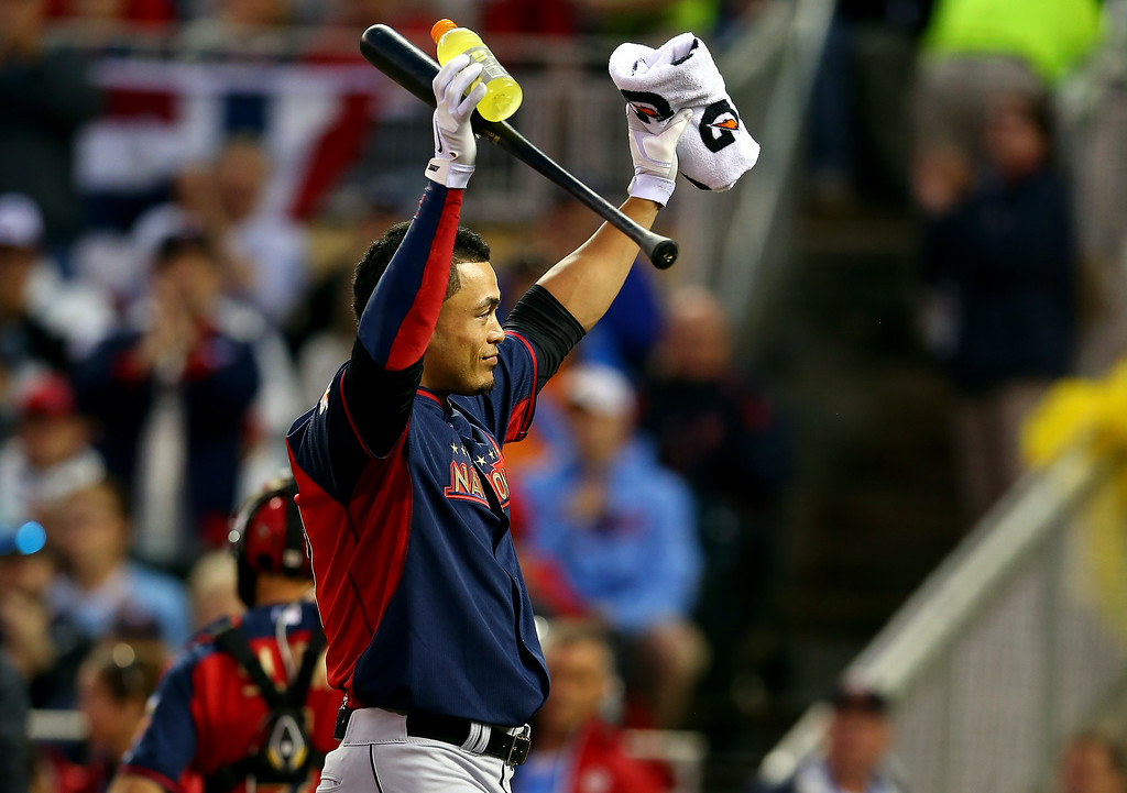 . National League All-Star Giancarlo Stanton #27 of the Miami Marlins reacts after batting during the Gillette Home Run Derby at Target Field on July 14, 2014 in Minneapolis, Minnesota.  (Photo by Elsa/Getty Images)