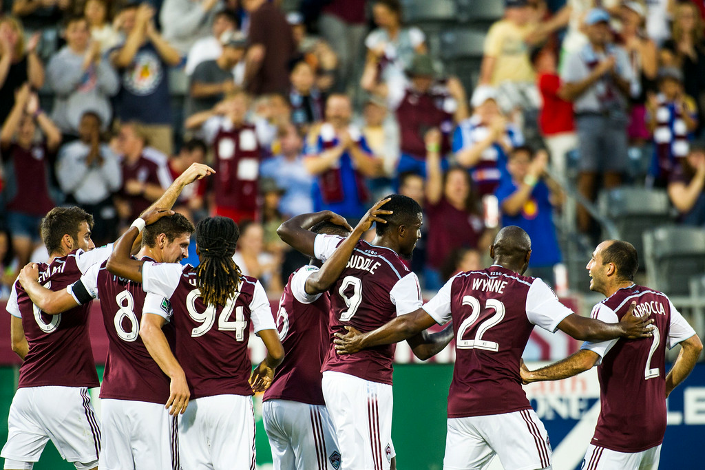. COMMERCE CITY, CO - AUGUST 20:  The Colorado Rapids celebrate Edson Buddle (9) of Colorado Rapids\'s 100th Career Goal during a Major League Soccer game at Dick\'s Sporting Goods Park on Wednesday, August 20, 2014 in Commerce City, Colorado.  Director Comey\'s visit to the Dick\'s Sporting Goods Park is part of his plan to visit all FBI Field Offices in his first year as director.  (Photo by Kent Nishimura/The Denver Post)