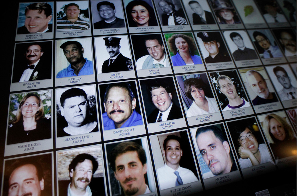 . This Sept. 10, 2012 file photo shows electronic images of victims of the attacks of Sept. 11, 2001, destined to be a part of the future 9/11 Memorial Museum, during a news conference in New York. (AP Photo/Mark Lennihan, File)