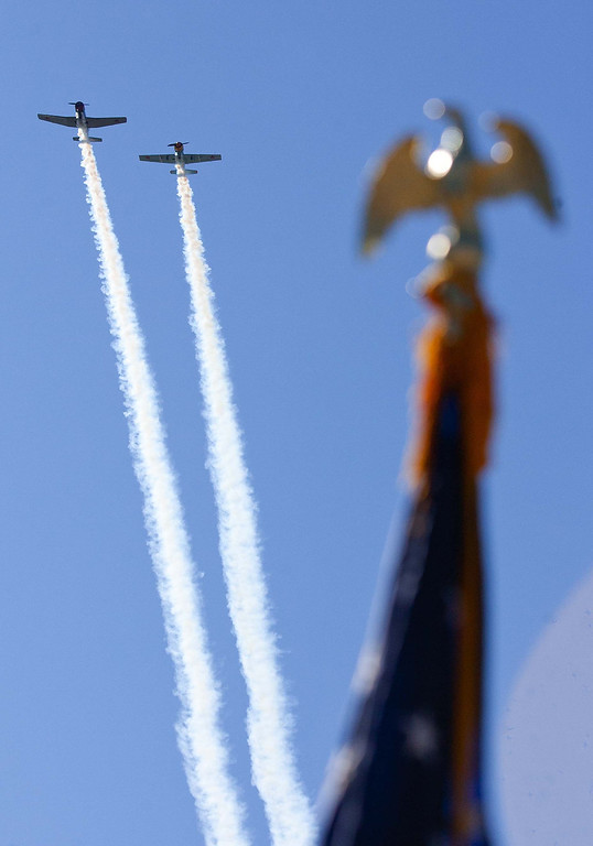 . A two plane fly-over passes over Veterans Park in Florence, Ala., Monday Nov. 11, 2013, for the beginning of the Veteran\'s Day program.(AP Photo/TimesDaily,Matt McKean)
