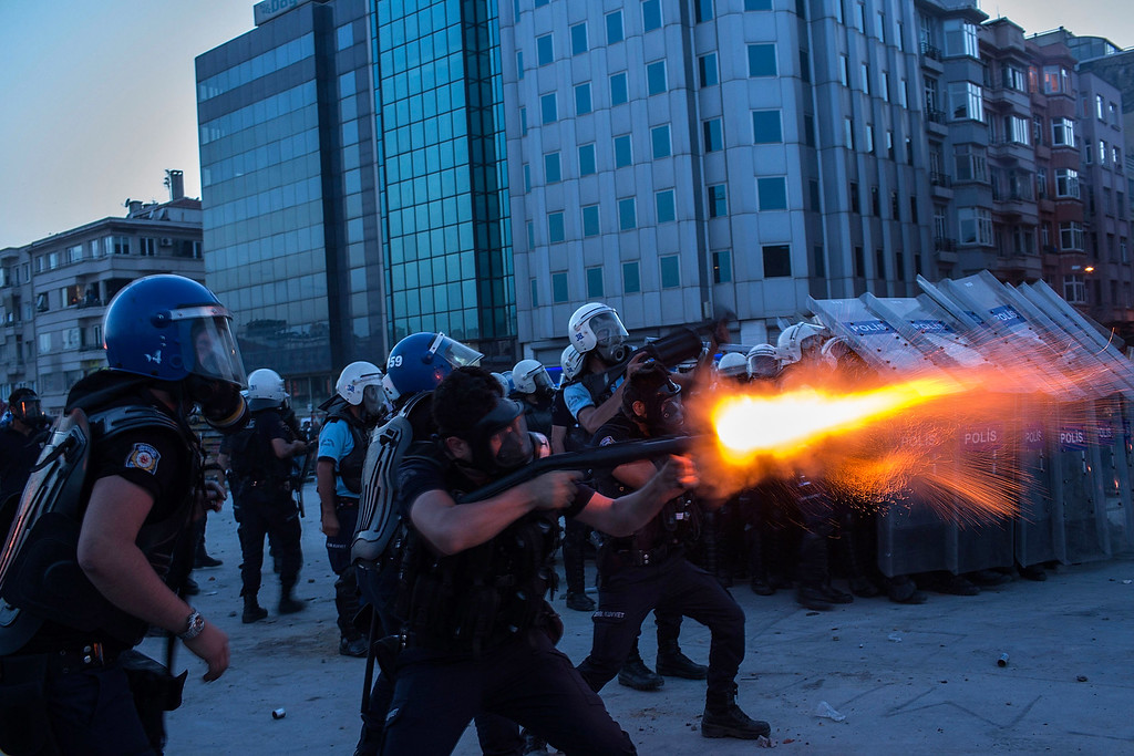 . Riot police fire tear gas to disperse the crowd during a demonstration near Taksim Square on June 11, 2013 in Istanbul, Turkey.  (Photo by Lam Yik Fei/Getty Images)