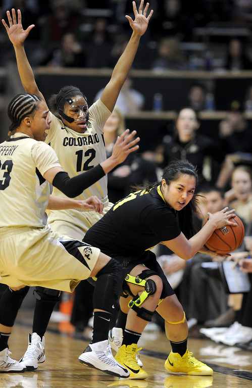. Chucky Jeffery and Ashley Wilson, both of CU, trap Amanda Delgado of Oregon. Cliff Grassmick / February 10, 2013