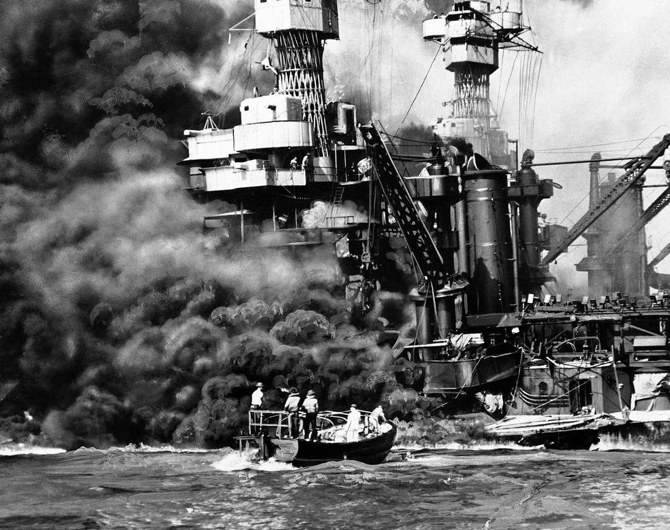 ". In this Dec. 7, 1941 file photo provided by the U.S. Navy, a Navy launch pulls up to the blazing USS West Virginia to rescue a sailor during the attack on Pearl Harbor. An excavation crew recently made a startling discovery at the bottom of Pearl Harbor when it unearthed a skull that archeologists suspect is from a Japanese pilot who died in the historic attack. Archaeologist Jeff Fong of the Naval Facilities Engineering Command Pacific described the discovery to The Associated Press and the efforts under way to identify the skull. He said the early analysis has made him ""75 percent sure\"" that the skull belongs to a Japanese pilot.  (AP Photo/U.S. Navy, file)"