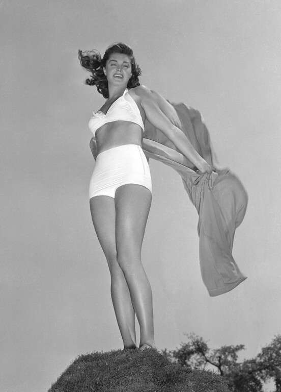 """. Esther Williams, the theme girl of the first annual Los Angeles Swimming and Diving Contest to be held in September 1942, is seen in this August 1942 photo. Williams was a swimming champion who turned to acting where she was able to use her aquatic skills in such films as \""""Easy to Wed,\"""" \""""Neptune\'s Daughter\"""" and \""""Dangerous When Wet.\"""" (AP Photo)"""