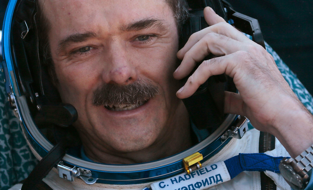 . Canadian astronaut Chris Hadfield speaks on the phone after the Russian Soyuz space capsule landed some 150 km (90 miles) southeast of the town of Zhezkazgan, in central Kazakhstan May 14, 2013.  REUTERS/Mikhail Metzel/Pool