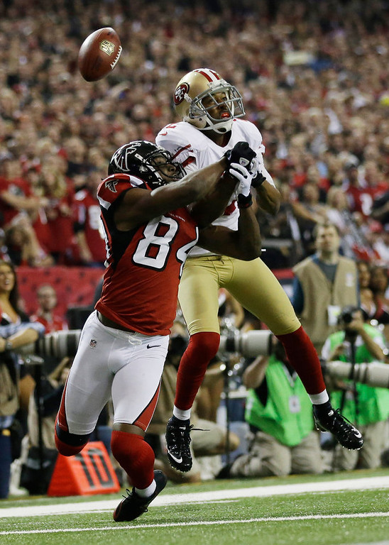 . Atlanta Falcons\' Roddy White (84) breaks up a pass intended for San Francisco 49ers\' Carlos Rogers during the second half of the NFL football NFC Championship game Sunday, Jan. 20, 2013, in Atlanta. (AP Photo/David Goldman)