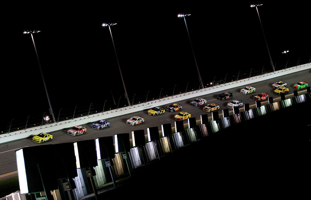. Matt Kenseth, driver of the #20 Dollar General Toyota, leads a pack of cars during the NASCAR Sprint Cup Series Budweiser Duel 1 at Daytona International Speedway on February 20, 2014 in Daytona Beach, Florida.  (Photo by Sean Gardner/Getty Images)