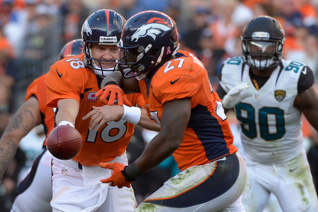 . DENVER, CO. - October 13: Denver Broncos quarterback Peyton Manning #18 handing off to running back Knowshon Moreno #27 in the 4th quarter vs the Jacksonville Jaguars at Sports Authority Field at Mile High. August 13, 2013 Denver, October. (Photo By Joe Amon/The Denver Post)