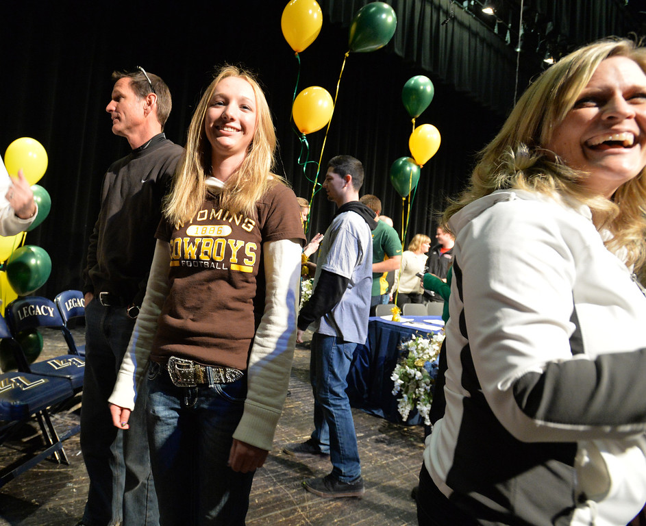 . Legacy\'s Sarah Hankins poses with her father Todd for pictures after signing to the University of Wyoming for golf during National Signing Day at Legacy High.  For more photos and video please go to broomfieldenterprise.com. February 5, 2014 staff photo/ David R. Jennings