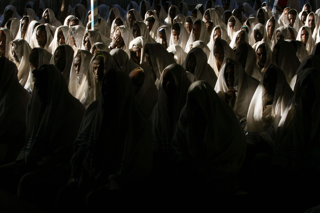 . GONDAR, ETHIOPIA - APRIL 29: Ethiopian Jewish men wear prayer shawls as they pray in a synagogue on April 29, 2007 in Gondar in northern Ethiopia. Some 2,500 Ethiopians of Jewish origin from this province remain in the East African country as Israel slowly brings them over, a few dozen at a time, on commercial flights. Since 1984, more than 73,000 Ethiopian Jews have been settled in Israel. (Photo by Uriel Sinai/Getty Images)