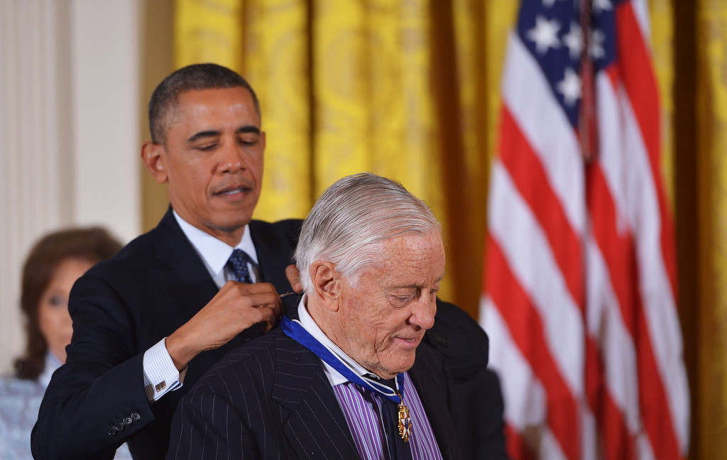 . US President Barack Obama presents the Presidential Medal of Freedom to former Washington Post executive editor Ben Bradlee during a ceremony in the East Room of the White House on November 20, 2013 in Washington, DC.  AFP PHOTO/Mandel  NGAN/AFP/Getty Images
