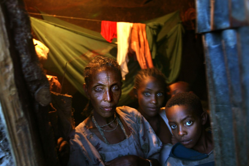 . GONDAR, ETHIOPIA - APRIL 30: Ethiopian Jews look out the door of their adobe mud hut on April 30, 2007 in Gondar in northern Ethiopia. Some 2,500 Ethiopians of Jewish origin from this province remain in the East African country as Israel slowly brings them over, a few dozen at a time, on commercial flights. Since 1984, more than 73,000 Ethiopian Jews have been settled in Israel. (Photo by Uriel Sinai/Getty Images)