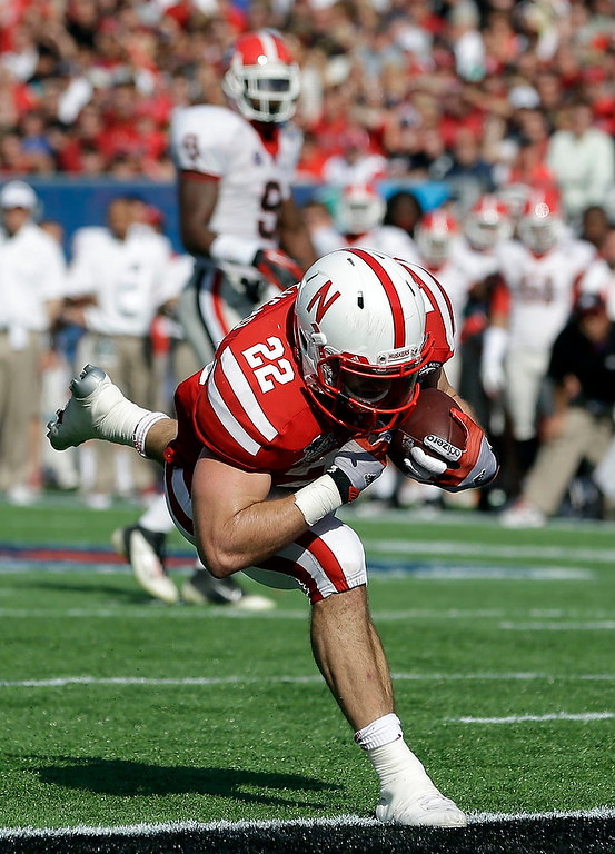 . Nebraska running back Rex Burkhead (22) crosses the goal line for a touchdown on a 16-yard pass play against Georgia during the first half of the Capital One Bowl NCAA football game, Tuesday, Jan. 1, 2013, in Orlando, Fla. (AP Photo/John Raoux)