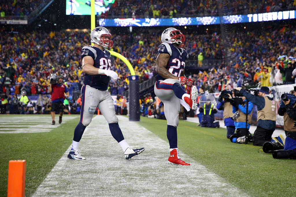 . FOXBORO, MA - JANUARY 11:  Stevan Ridley #22 of the New England Patriots celebrates with teammate Matthew Mulligan #88 after scoring a 3 yard touchdown in the third quarter against the Indianapolis Colts during the AFC Divisional Playoff game at Gillette Stadium on January 11, 2014 in Foxboro, Massachusetts.  (Photo by Elsa/Getty Images)