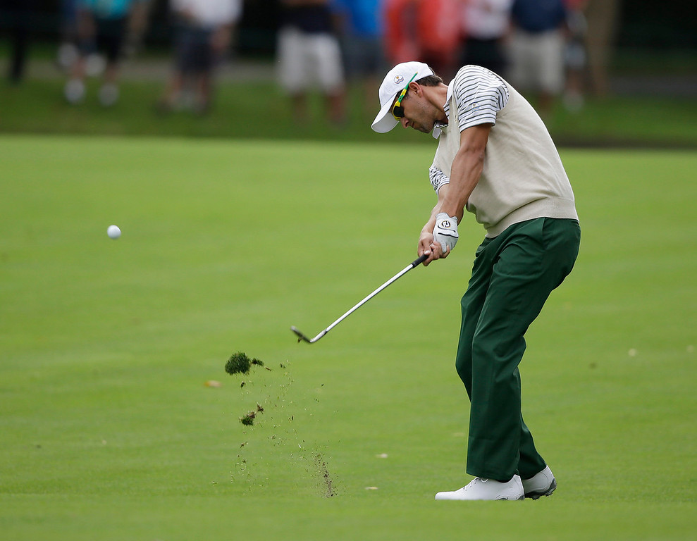 . International team player Adam Scott, of Australia, hits from the fairway the second hole during a four-ball match against the United States at the Presidents Cup golf tournament at Muirfield Village Golf Club Thursday, Oct. 3, 2013, in Dublin, Ohio. (AP Photo/Darron Cummings)