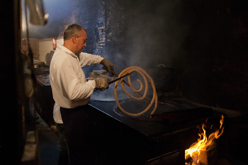 . PAMPLONA, SPAIN - JULY 11:  A man makes \'churros\' at Churreria Manueta in the early morning during the sixth day of the San Fermin Running Of The Bulls festival on July 11, 2013 in Pamplona, Spain. Churreria de la Manueta has been making \'churros\' since 1872 in a traditional way. The annual Fiesta de San Fermin, made famous by the 1926 novel of US writer Ernest Hemmingway \'The Sun Also Rises\', involves the running of the bulls through the historic heart of Pamplona, this year for nine days from July 6-14.  (Photo by Pablo Blazquez Dominguez/Getty Images)