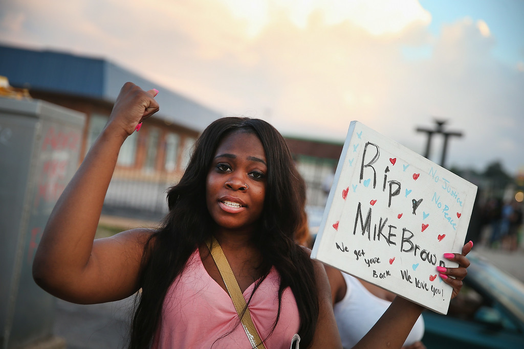 . Arniesha Randall protests the killing of 18-year-old Michael Brown who  was shot by police on Saturday on August 11, 2014 in Ferguson, Missouri. Police responded with tear gas and rubber bullets as residents and their supporters protested the shooting by police of an unarmed black teenager named Michael Brown who was killed Saturday in this suburban St. Louis community. Yesterday 32 arrests were made after protests turned into rioting and looting in Ferguson.  (Photo by Scott Olson/Getty Images)