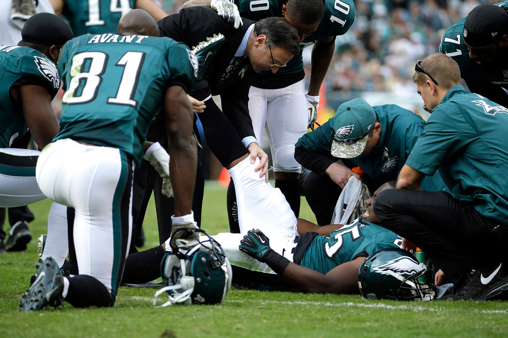 . Philadelphia Eagles trainers tend to running back LeSean McCoy during the first half of an NFL football game against the Washington Redskins in Philadelphia, Sunday, Nov. 17, 2013. (AP Photo/Matt Slocum)
