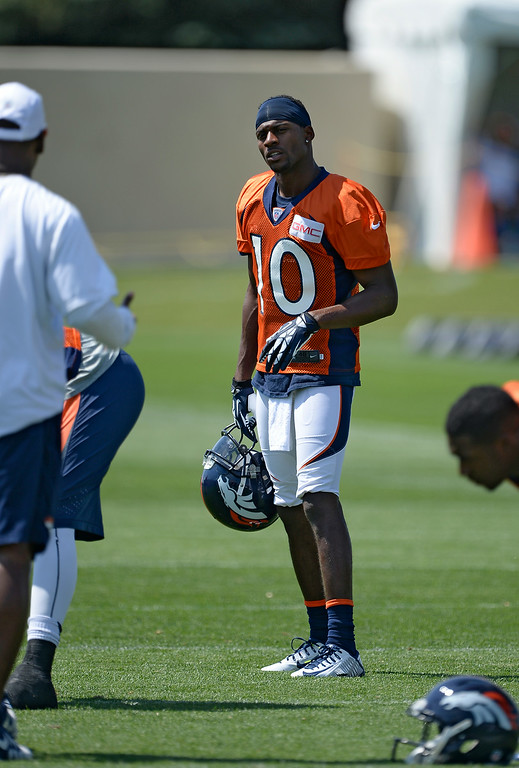 . Denver Broncos wide receiver Emmanuel Sanders (10) gets ready for drills after stretching during day two of the Denver Broncos 2014 training camp July 25, 2014 at Dove Valley. (Photo by John Leyba/The Denver Post)