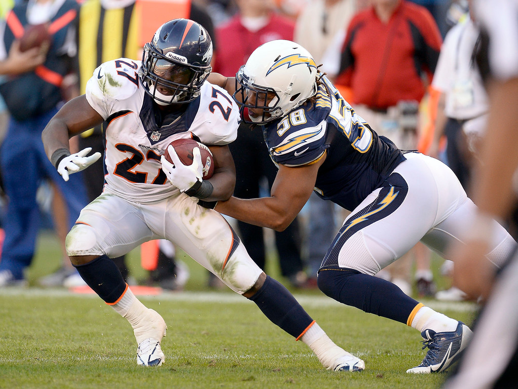 . Denver Broncos running back Knowshon Moreno (27) slips a ankle by San Diego Chargers outside linebacker Tourek Williams (58) during the third quarter at Qualcomm Stadium. (Photo by John Leyba/The Denver Post)