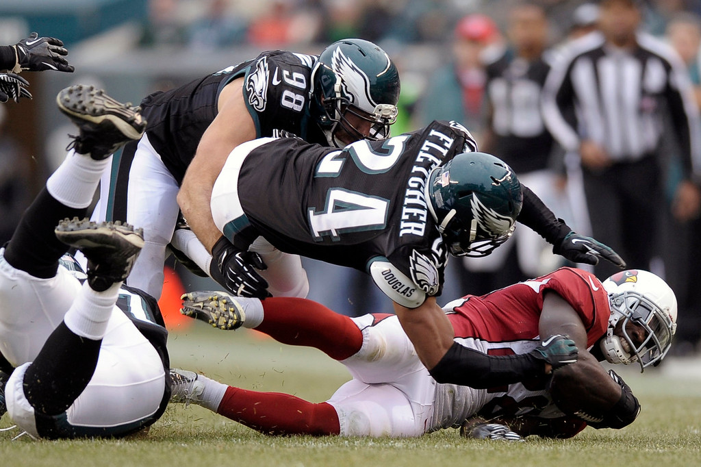 . Arizona Cardinals\' Rashard Mendenhall, right, is tackled by Philadelphia Eagles\' Bradley Fletcher, center, and Connor Barwin during the second half of an NFL football game, Sunday, Dec. 1, 2013, in Philadelphia. (AP Photo/Michael Perez)