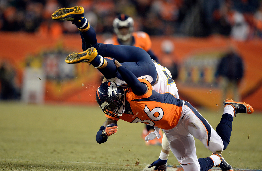 . Denver Broncos cornerback Kayvon Webster (36) takes down San Diego Chargers running back Ryan Mathews (24) during the second half.  The Denver Broncos vs. the San Diego Chargers at Sports Authority Field at Mile High in Denver on December 12, 2013. (Photo by Hyoung Chang/The Denver Post)