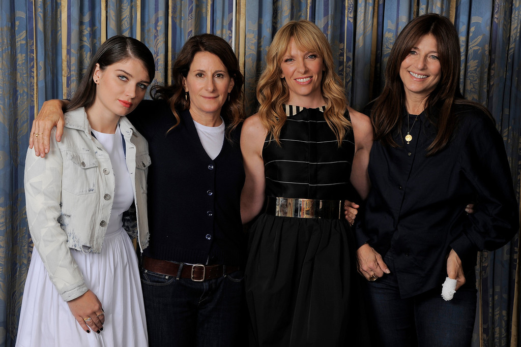 ". Wriet-director Nicole Holofcener, second from left, of the film ""Enough Said,\"" poses with cast members, from left, Eve Hewson, Toni Collette and Catherine Keener on day 4 of the 2013 Toronto International Film Festival on Sunday, Sept. 8, 2013 in Toronto. (Photo by Chris Pizzello/Invision/AP)"
