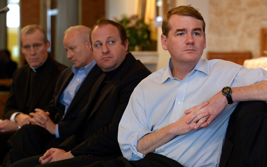 . AURORA, CO- FEBRUARY 9: US Senator Michael Bennet, right, is accompanied by Colorado Representatives Jared Polis, second from right and Mike Coffman second from left, as they wait their turn to speak to the capacity crowd.  TOGETHER COLORADO held a public meeting  to talk about the United States immigration policies at St. Therese Catholic Church, 1243 Kingston Street in Aurora, Co  on February 9th, 2013.   Colorado State Senator Michael Bennet, and Colorado Representatives Mike Coffman and Jared Polis attended and spoke at the meeting.  The organization wanted to tell the state\'s representatives why they want a road map to citizenship for 11 million aspiring Americans.  More than 800 faith and community leaders packed the small church in Aurora. (Photo By Helen H. Richardson/ The Denver Post)