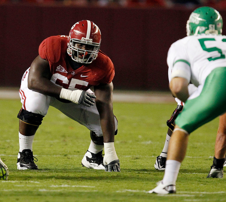 . Offensive linesman Chance Warmack #65 of the Alabama Crimson Tide lines up against the North Texas Mean Green on September 17, 2011 at Bryant-Denny Stadium in Tuscaloosa, Alabama. (Photo by Butch Dill/Getty Images)