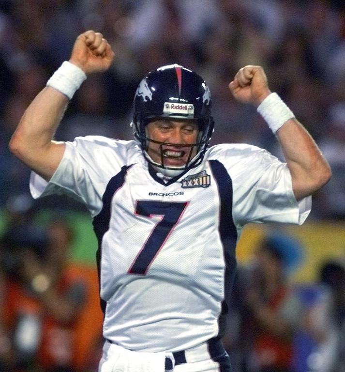 . Denver Broncos quarterback John Elway celebrates a Broncos fourth quarter touchdown against the Altanta Falcons in Super Bowl XXXIII in Miami, Sunday, Jan. 31, 1999. The Broncos defeated the Falcons 34-19. (AP Photo/Doug Mills)